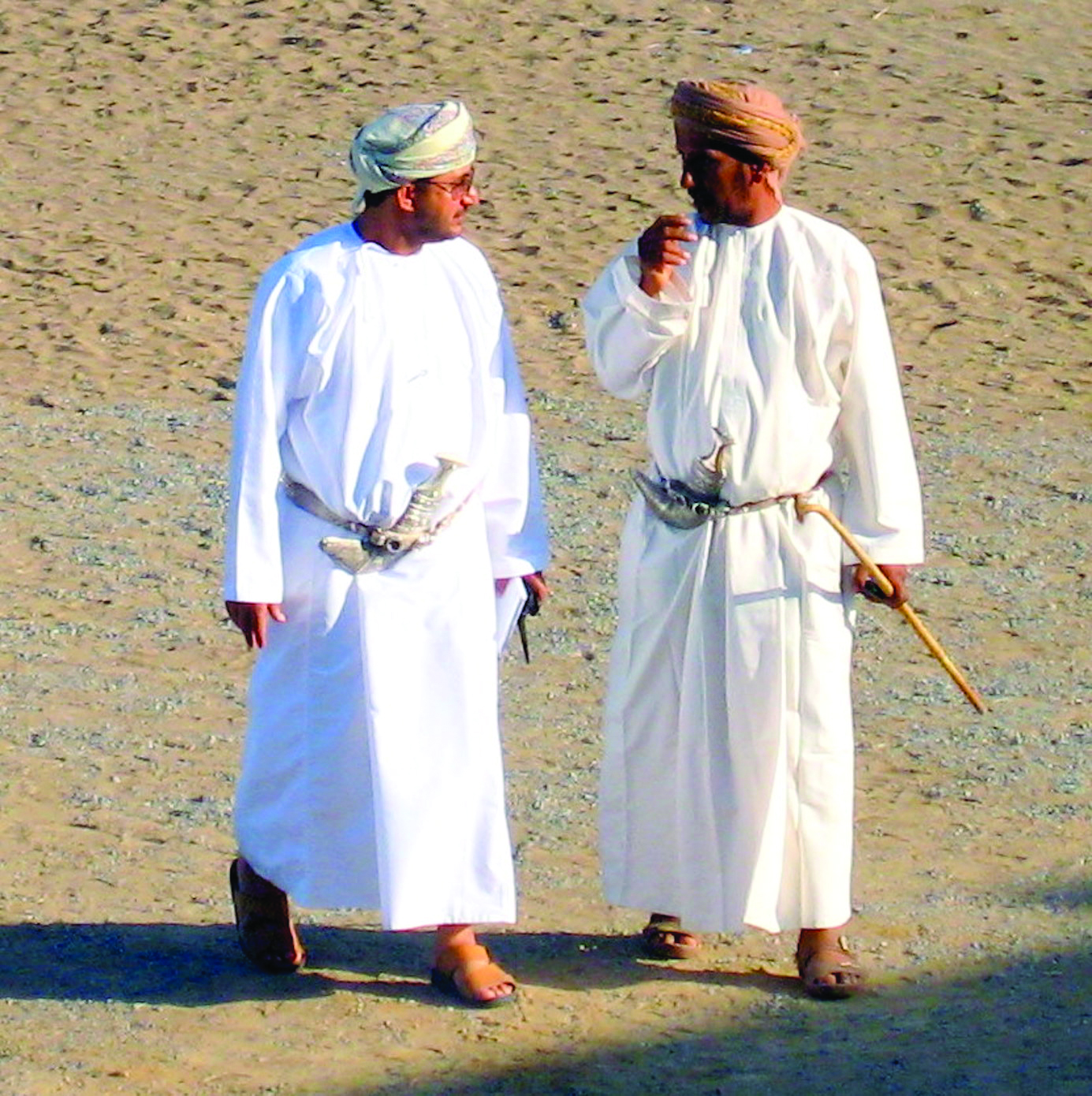 2b164dcb598 Omani men in Adam wearing national dress at a camel race