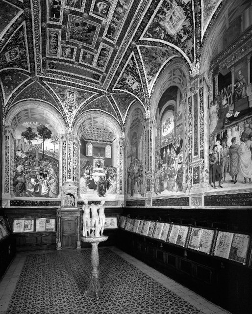Fig. 4. Interior View of the Piccolomini Library with frescoes by Pintoricchio and statue of the three Graces. Libreria Piccolomini, Duomo, Siena, Italy.: Scala / Art Resource, NY.