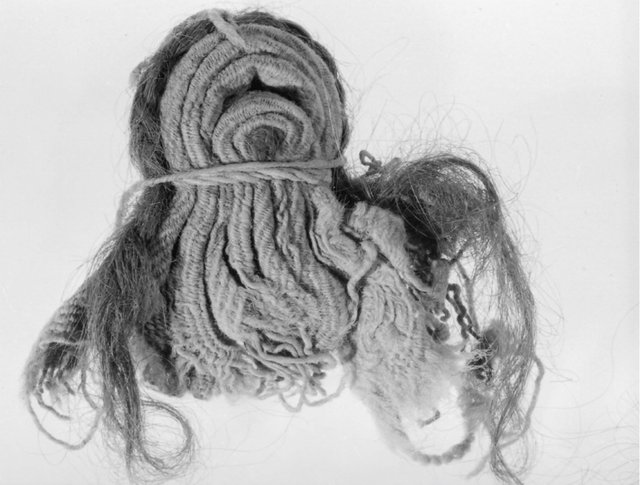 Fig. 8. Doll-figurine with plaited hair, 7.5 × 8.5 cm. KM 3543 (not previously published.)
