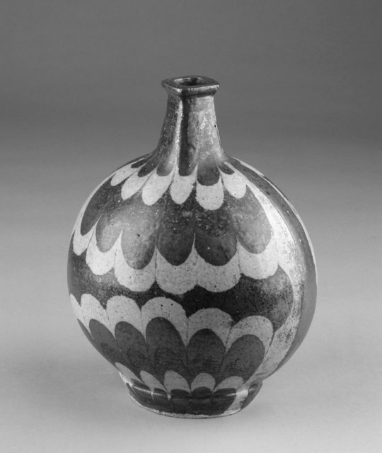 Ovoid vase, ca. 1930-1950. Stoneware with iron glaze; scallop design created with wax resist, 24.8  × 19.6 ×  16 cm.  Gift of Mr. and Mrs. Stephen H. Spurr, 2003/2.15