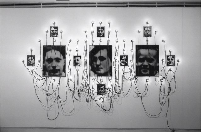 Boltanski, Christian, France, born 1944. Monument to the Lycee Chases, 1989. Gelatin silver prints, biscuit tins, electric cables, and sixty-eight light bulbs, 300 x 200 cm. Museum purchase made possible by the W. Hawkins Ferry Fund and anonymous individual benefactors, 2006/1.154