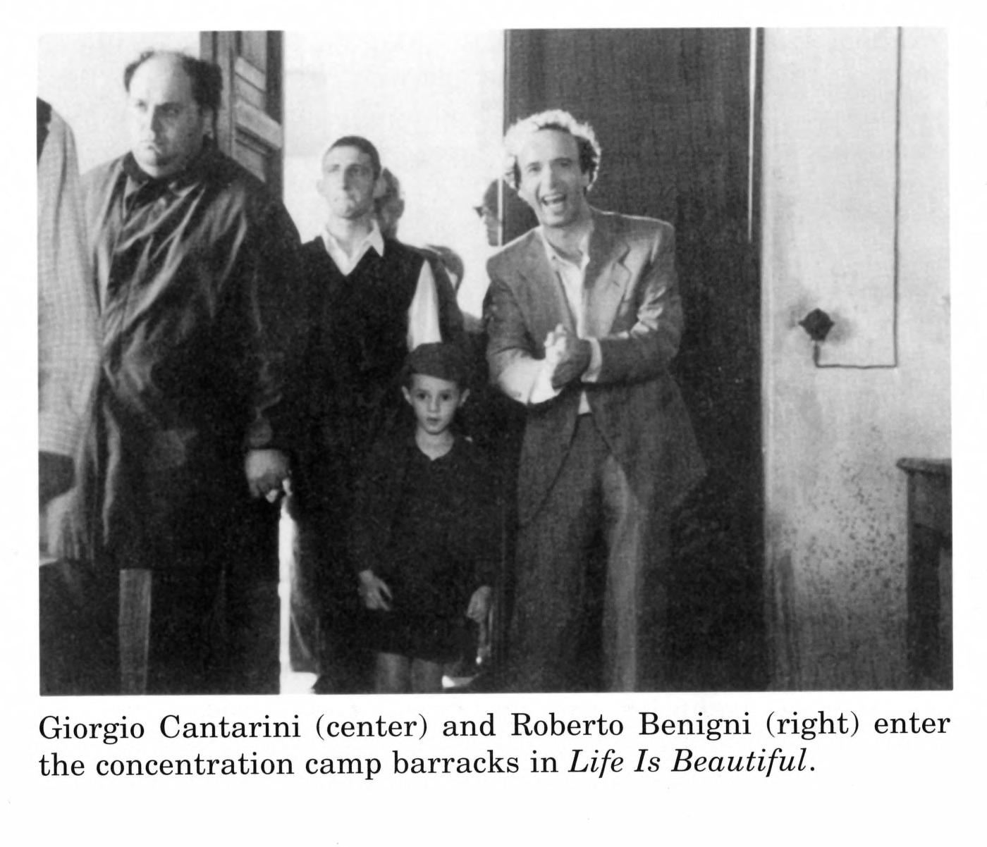 Michigan Quarterly Review Images: Giorgio Cantarini (center) and Roberto  Benigni (right) enter the concentration camp barracks in Life Is Beautiful.