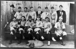 Wyandotte High School Baseball Team (some seated on pews)
