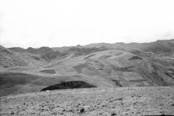 Facing NE over large site on distant sharp peak at center of photo, above Sites 406 & 407
