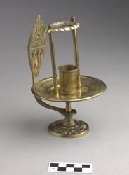 Candlestick with flame-shaped handle; brass, 4