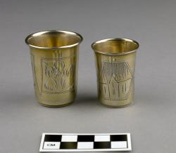 Small Cups for Kiddush (2); sterling silver,similar to JHC-R3133; not identical in size or design but with similar engravings of plants and buildings