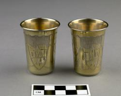 Small Cups for Kiddush (2); sterling silver, similar to JHC-R3132; not identical in design but with similar engravings of plants and buildings