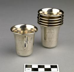 Small Cups for Kiddush (6); sterling silver, identical in size and design with engravings of the Star of David and other symbols; designs are similar to JHC-R3137, R3139, R3141, and R3144