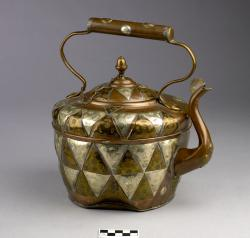 Kettle; copper with sterling silver and copper triangular overlays; marked with Star of David and C. H. Laubenburg, Birmingham, under the lid; damge near base said to have come during WWII.