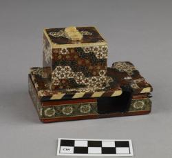 Phylactery holder; wood with intricate painted design