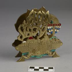 Napkin or letter holder; brass, decorated with colored inlays and fake