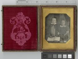 [Portrait of two children holding cased photograph].