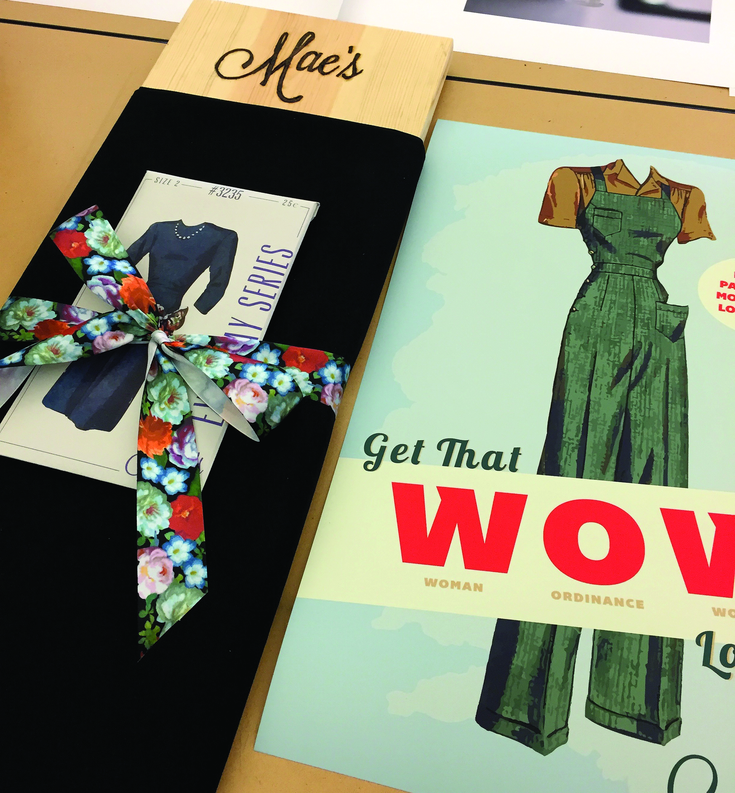 Figure 2:Mae's fashion patterns and bundled fabrics were developed so clothing could be made within United States World War II rationing standards while activating the persona's love of sewing. Designed by Brittany Hogan.