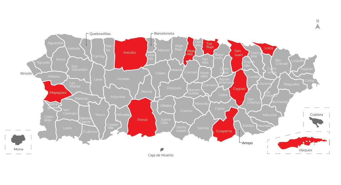 "Figure 1: Puerto Rico is geographically divided into 78 municipios, which are roughly equivalent to American counties. Each municipio functions as a governmental entity. Those municipios indicated in red on this map indicate areas within which projects that were documented in ""Listening to Their Voices"" transpired."