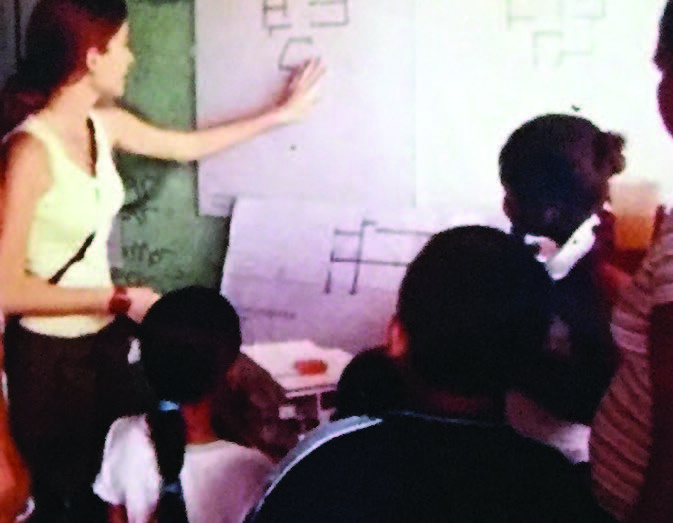 Figure 9: A presentation of the design proposals to the girls and boys of Casa Nueva Esperanza (New Hope House) in the municipio (municipality) of Toa Baja on Puerto Rico's northern coast (2003). This was a way for them to take part in and have a closer understanding of what was being designed for them. (Photo provided by Taller de Diseño Comunitario)