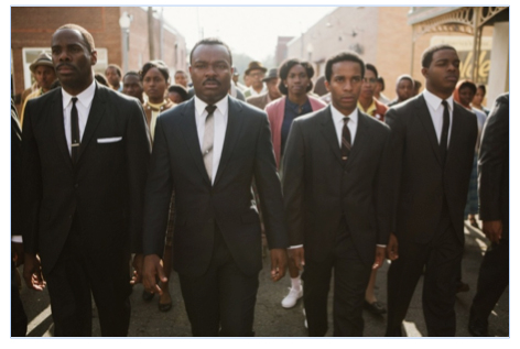 Fig. 1: David Oyelowo (second from the left) portrays Martin Luther King in Selma.