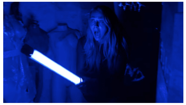 "Fig. 3: Rebecca's use of the ""black light"" allows her to fully confront the horror that is Diana, but the ultraviolent images surrounding her are predominantly blue."