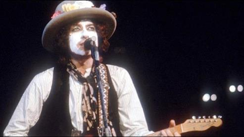 Figure 7. Jim James and Bob Dylan wear whiteface masks.