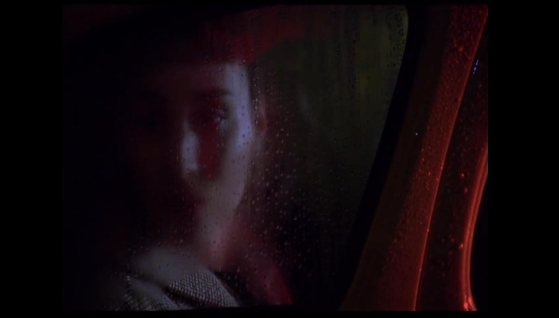 Figure 2: Therese in a car at night, remembering.