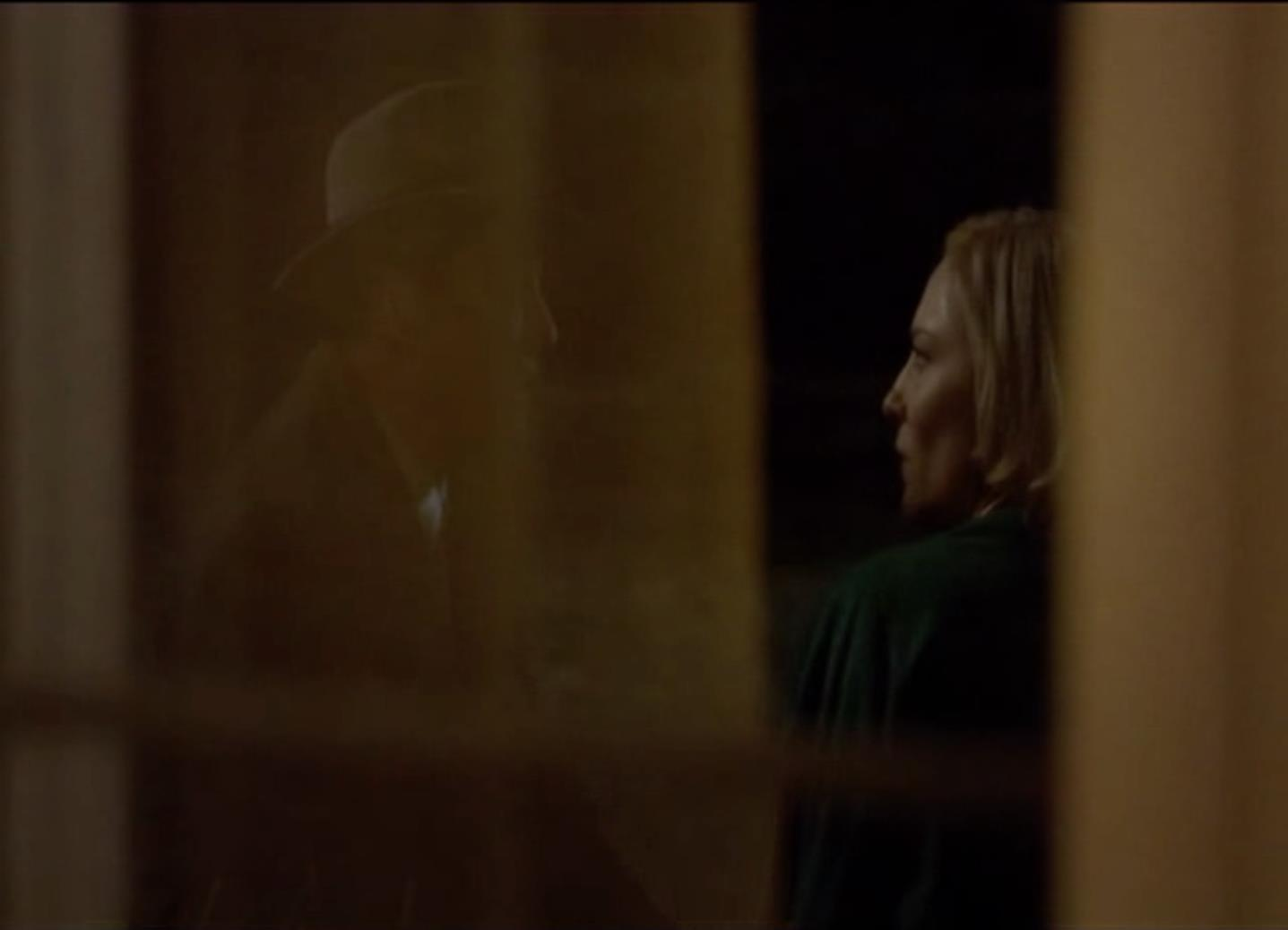 Figure 3: Carol and Harge, through a window, arguing.