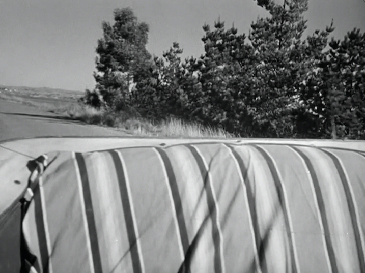 Figure 3. The fancy carnival tent seats in Baker's jalopy.