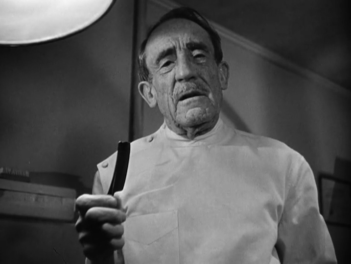 "Figure 9. ""Ever see any botched plastic jobs?"" Dr. Coley asks, as he preps Bogart for an operation."