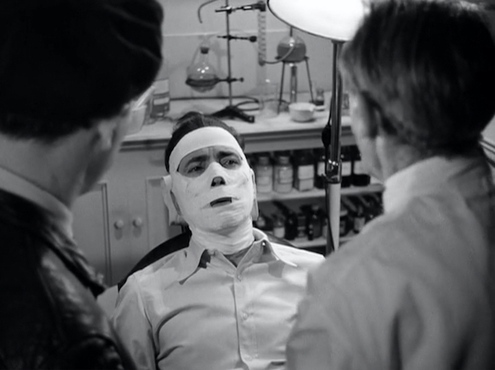 Figure 12. Bogart's face is revealed for the first time through the camera's third-person perspective, but remains hidden behind bandages that restrict his ability to talk.