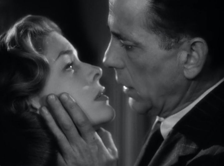 Figure 15. Bogart and Bacall kiss, renewing the pleasure we experienced watching similar scenes from their first two films together.