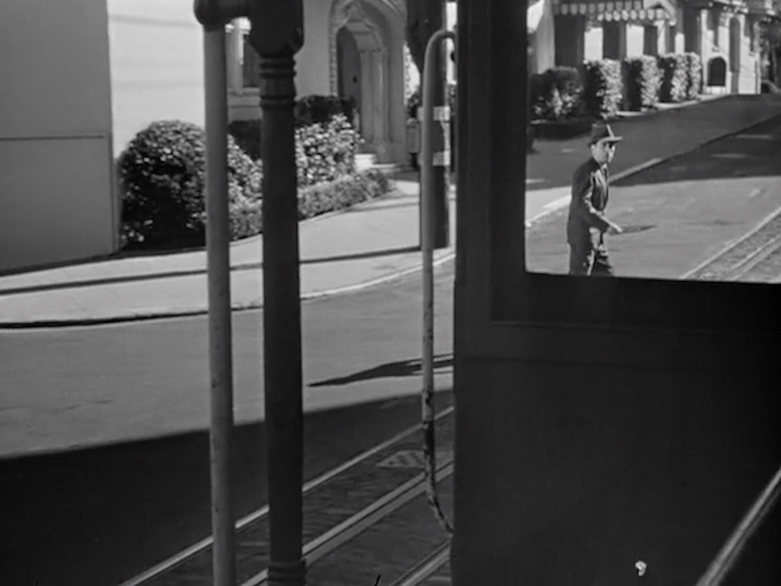 Figure 27. Bogart the celebrity artist on location in San Francisco, preparing to board a streetcar.