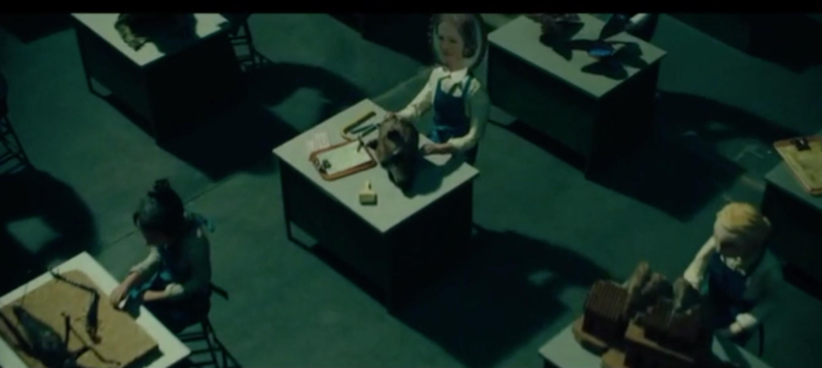 Figure #7: A puppet version of Rose in the diorama among an array of desks in Wonderstruck