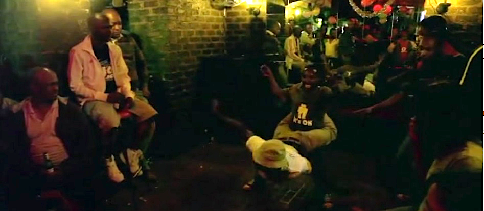 Figure 5: Prince and Mada dance Pantsula in a nightclub, still from The African Cypher.