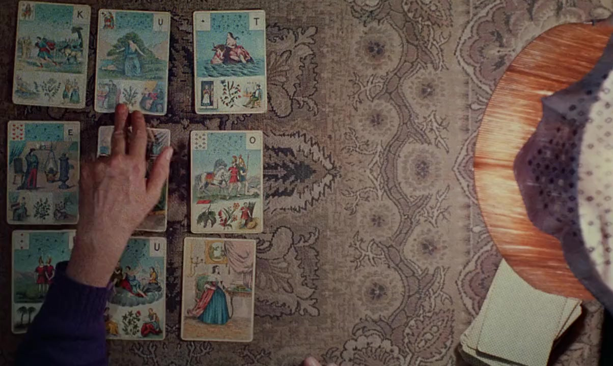 Figure 1: Cleo from 5 to 7 begins in color with tarot cards laying out a doomed life. The entire storyline of the black-and-white film is foretold.