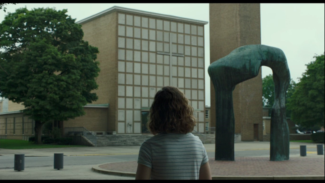 Figure 2. Casey facing Eliel Saarinen's First Christian Church and Henry Moore's Large Arch.