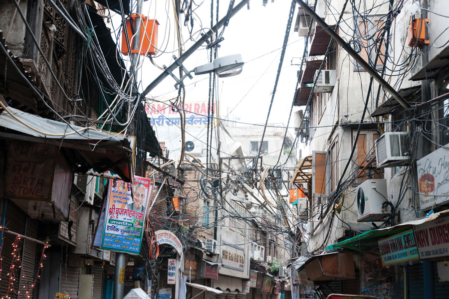 Figure 2.: Risky and chaotic electrical wiring in Old Delhi, India. The unsatisfying condition of wiring causes power problems in Delhi.