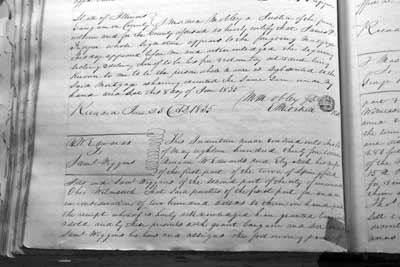 Figure 2. The May 16, 1835, land transaction between Mary Todd's brother- in-law, Ninian Wirt Edwards, and Samuel Wiggins is recorded on pages 310 and 311 of Sangamon County Record Book H.