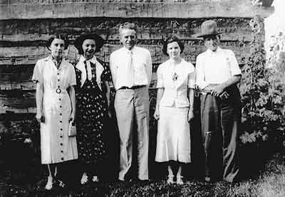 Figure 2. Pictured left to right ca. 1937: Grace Hagen, a friend of Mildred Howard; Mildred Howard, a daughter of Hattie Howell Howard; Louis Warren; Louise Hagen, sister of Grace Hagen; and Robert Thompson, who reconstructed the Lincoln Cabin in view behind the group. Photo courtesy Pearl Howard and John Young Howard.