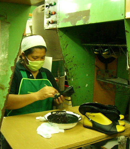 A worker at AA Footwear, which makes shoes under European licensure for the Thai market. JANE SHIM