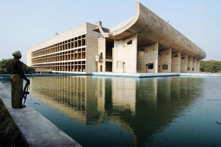 In this picture taken November 19, 2007, an Indian guard stands beside the Assembly Building of Chandigarh designed and built by Le Corbusier. NARINDER NANU/AFP/Getty Images