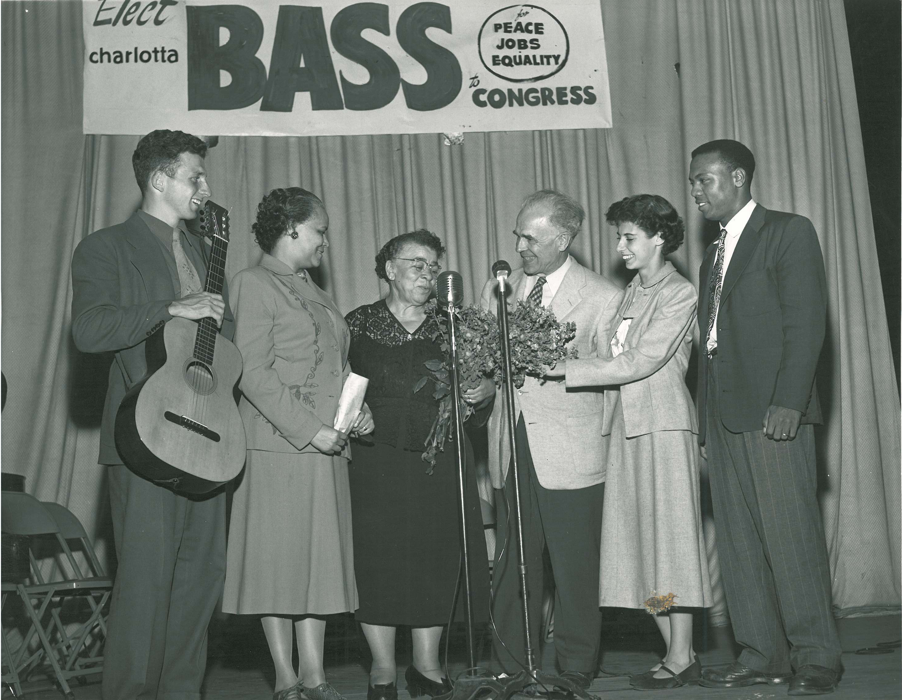 Figure 6.2. Charlotta Bass receives a bouquet of flowers at a congressional campaign rally in 1950. To her right is Reuben Borough, Progressive Party candidate for California treasurer; on the left is the folksinger Ernie Lieberman. Credit: Charlotta Bass Collection, Southern California Library (Los Angeles).