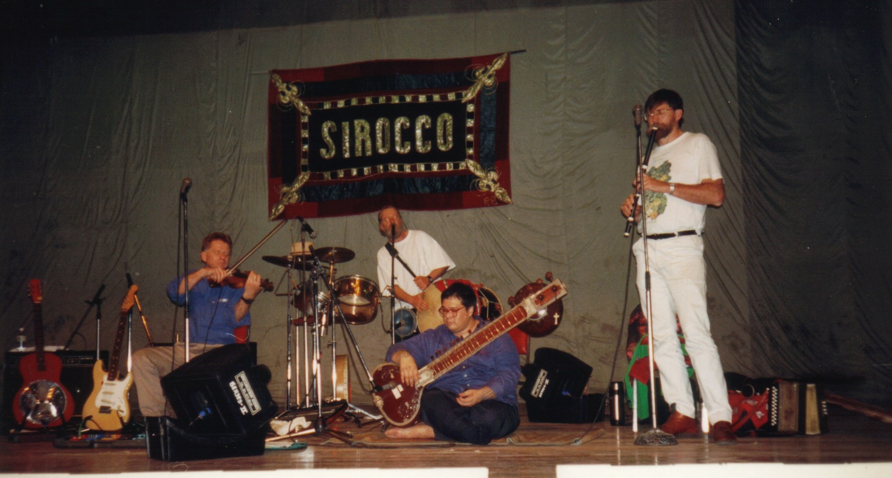 Figure 1. Sirocco rehearsing in Manila 1990 with Pilipino sitar player, Joey Valenciano. Left to right: Andrew de Teliga, Guy Madigan, Joey Valenciano, Bill O'Toole. (Photograph courtesy Bill O'Toole; used with permission.)