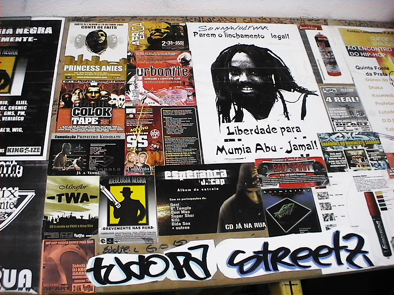 Figure 2.: Hip hop flyers decorating the table of the Khapaz rehearsal room.