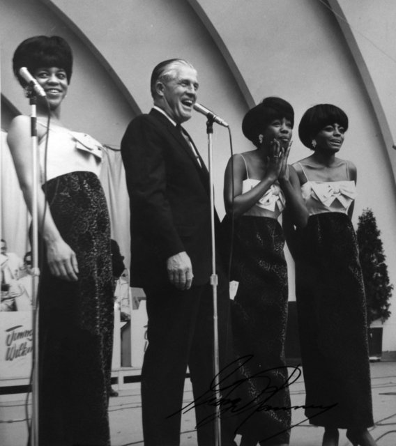 Michigan Governor George Romney posing with the Supremes (including, from left, Florence Ballard, Mary WIlson, and Diane Ross) at the Michigan State Fair, circa Labor Day 1965; note Romney's autograph in the lower right.: Image courtesy of Al Abrams