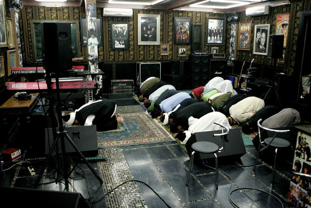 Praying at the studio of pop singer Ahmad Dhani before recording Ramadhan TV show