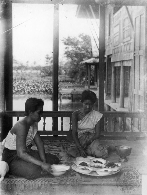 Figure 7. Aab and Uen Bunnag with meal on the veranda of Ruen Ton residence, Dusit. (N.d.).
