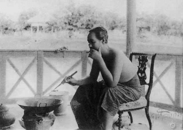 Figure 10. King Chulalongkorn cooking on the porch of the Ruen Ton residence, opposite Vimanmek Palace. (Courtesy of the Prince Damrong Library and Archive, Bangkok.).