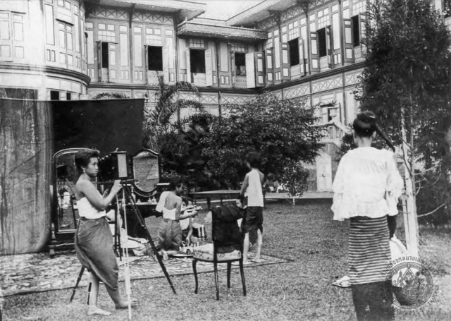 Figure 16. Erb and assistants set the scene in front of Vimanmek Palace as Princess Dara Rasami approaches. Note that Dara's hair is pulled up into a bun on top of her head here.