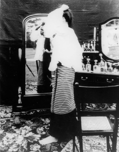 Figure 22. Princess Dara Rasami letting down her hair; note the way it becomes visible from behind in the full-length mirror.
