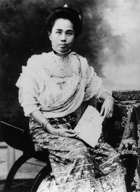 Figure 28. Recently promoted to the rank of High Queen [พระราชชายา], Dara Rasami poses for a formal portrait in her hometown, Chiang Mai. Note that she wears a phasin [skirt] made from a Burmese court textile called luntaya. (Probably taken at the Chiang Mai studio of Japanese photographer S. Tanaka, 1909.)