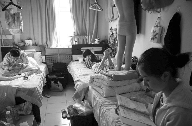 "Wang Lin, ""Three girls resting in the dorm; one, just returned from flight, hanging her uniform"" from Heaven & Earth series, Tianjin, 2008, 40x50cm."
