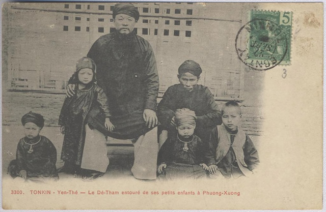 "Figure 3: series number 3300, Le Dê-Tham entouré de ses petits enfants à Phuong-Xuong, (""Dê-Tham surrounded by his small children at Phuong-Xuong [sic: Phồn Xương]""), image attributable to Captain Péri, postcard published by Pierre Dieulefils, Hanoi, ca. 1909, sent within northern Vietnam from one colonial military address  to another, postmarked September 27, 1909."